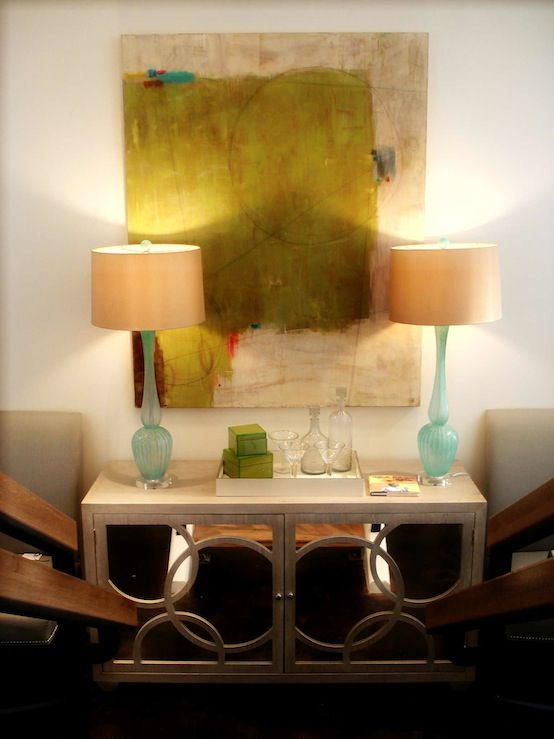 Chic foyer design with abstract painting, turquoise blue glass lamps ...
