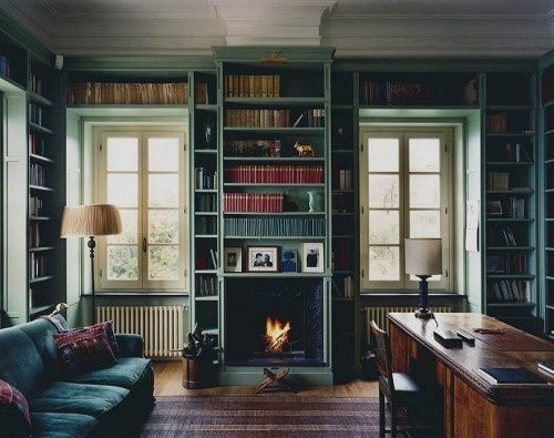 A Library Enveloped In Grayish Green Blue Painted Bookshelves With Handsome Moldings And Trim Work The Room Leaves Plenty Of Space For Cozy Fireplace