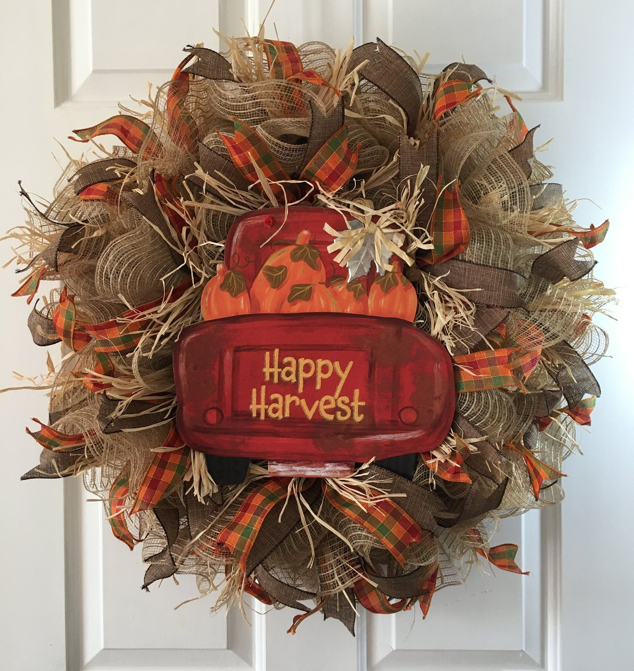 Red Truck Happy Harvest Fall Wreath, Autumn Wreath, Farmhouse Wreath, Country Wreath, Front Door Wreath Red Truck Happy Harvest Wreath is perfect to decorate your for the Fall Season. This wreath would also be great hanging over a fireplace or anywhere in you home or office. The wreath is made using jute deco mesh, wired ribbons, raffia, wood sign on a metal frame. The wreath is perfect for indoor or outdoor use.  Wreath measures about 24 inches and is about 6 inches deep. This wreath would also #fallwreaths