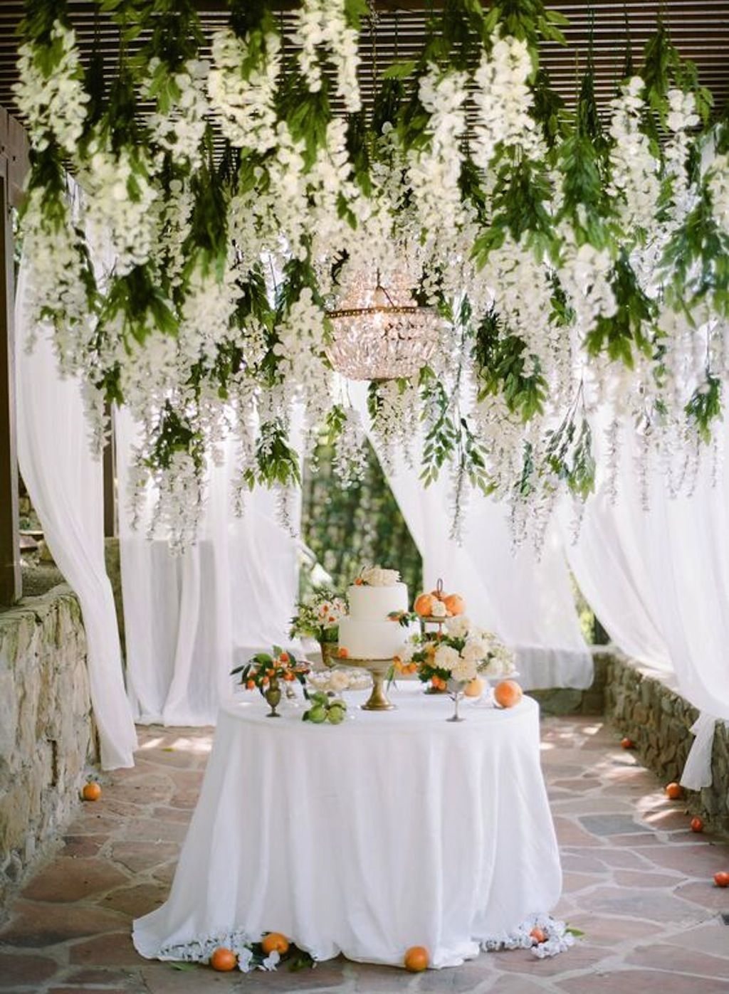 Chandelier glistens amidst a whimsical wisteria creation by Celadon ...
