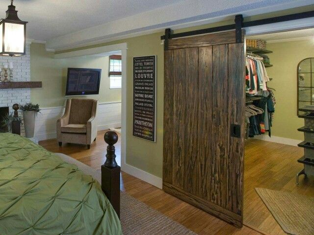 Love the sliding closet door. Looks kinda like a barn door. Cool.