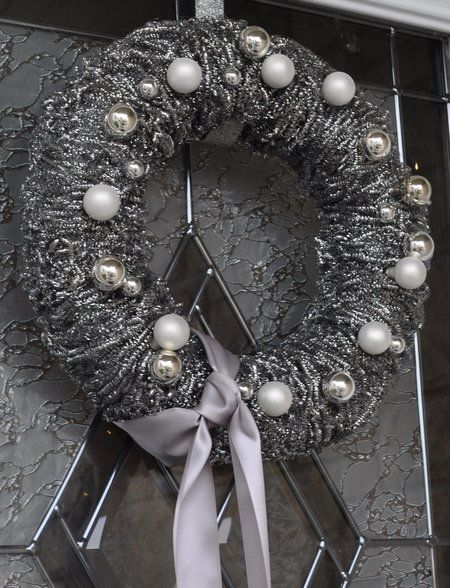 This wreath is an impressive upcycling craft that will wow anyone who walks past your door. The materials are most likely already in your home, and this wreath craft shows you how out of the box you can be with them.