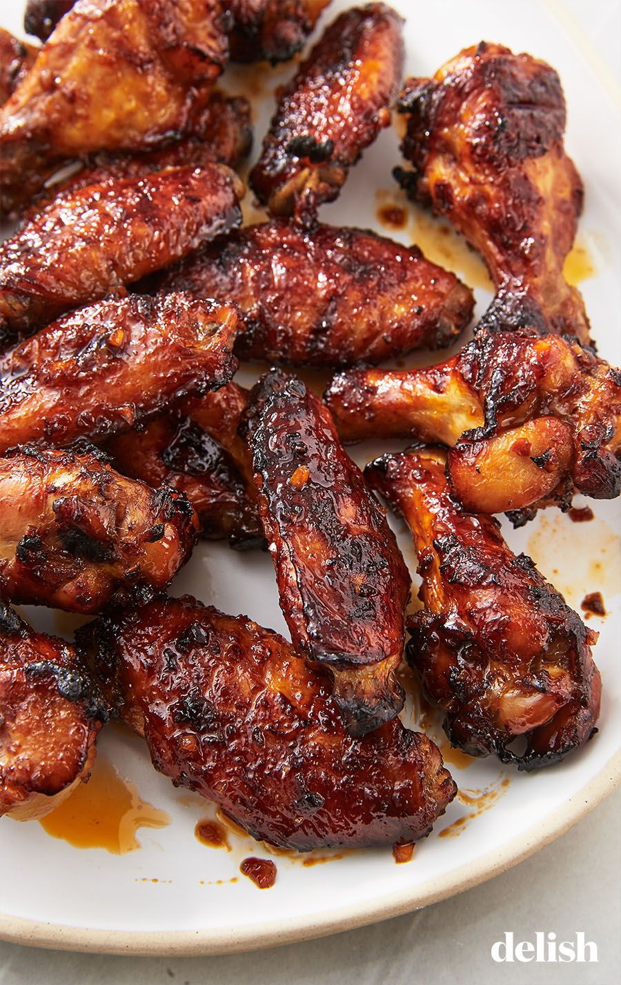 These Chicken Wings Have A Spicy Addicting Marinade Recipe Easy Chicken Recipes Chicken Wing Recipes Spicy Asian Chicken