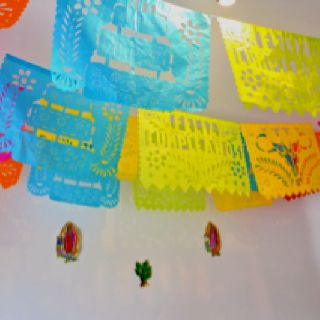Paper flags -bilingual-happy birthday in Spanish and English. Also available in Fiesta-Party and by special order... wedding names in white. The traditional Mexican way.