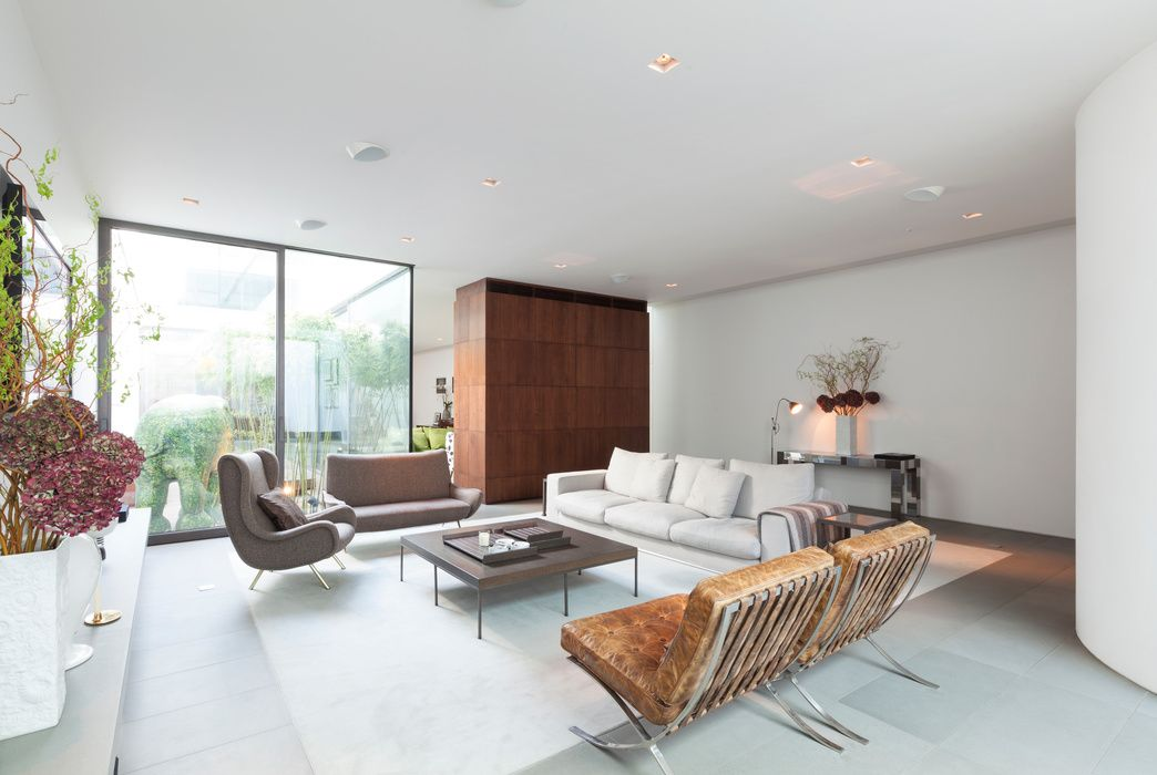 expansive architect designed living area with corten steel wall room