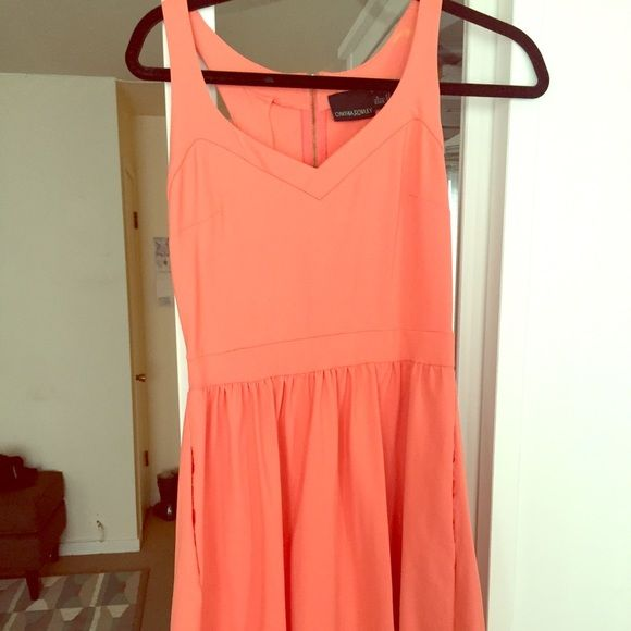 Coral Dress with Pockets! Great coral dress - stretchy and comfy. Has pockets! Great exposed zipper in the back. Worn a handful of times after purchasing off Posh :). Last photo shows some slight discoloration - but it is only on the inside of the strap, not visible when worn. Always happy to negotiate the price! Cynthia Rowley Dresses