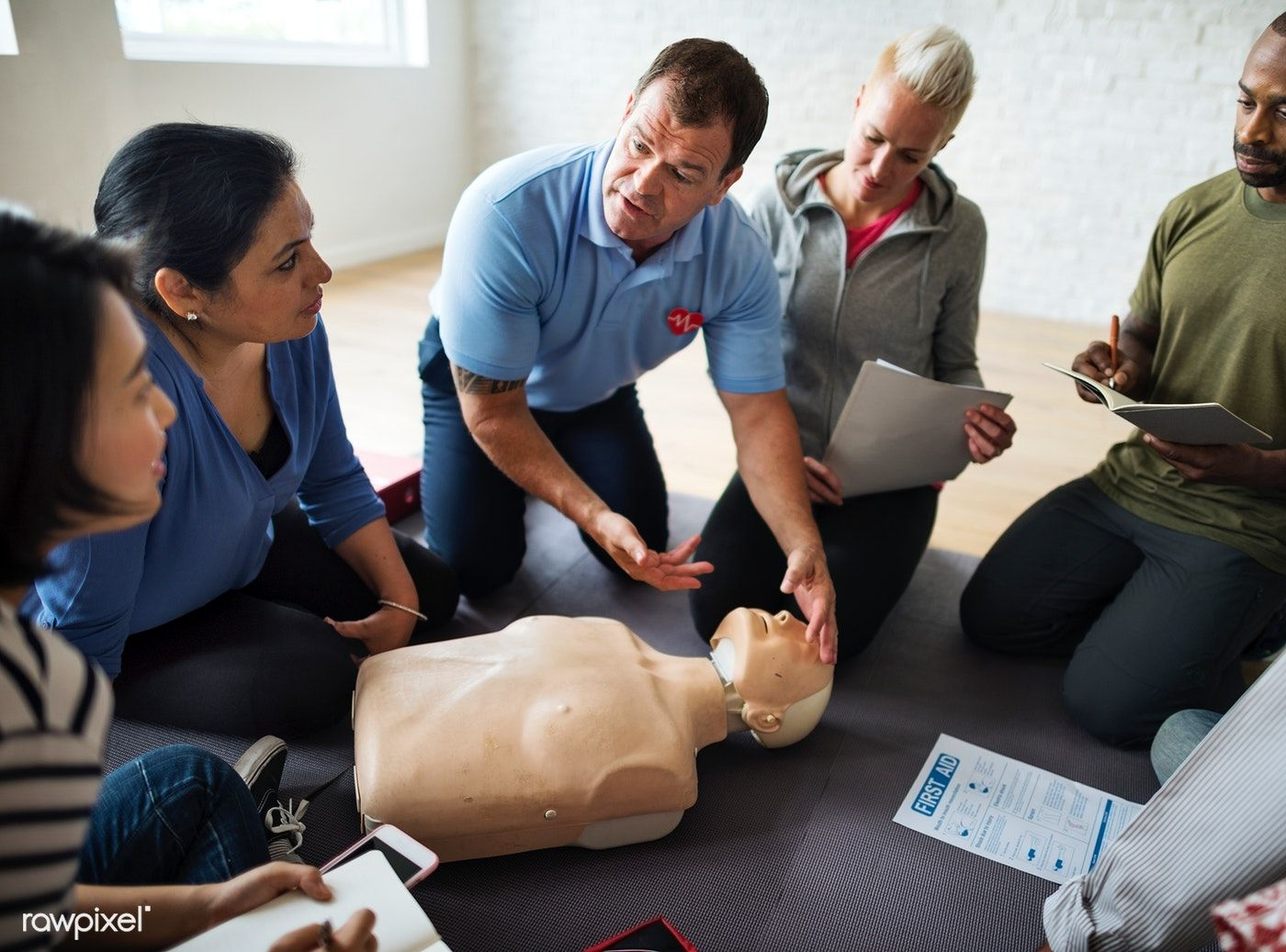 Download premium photo of CPR first aid training class