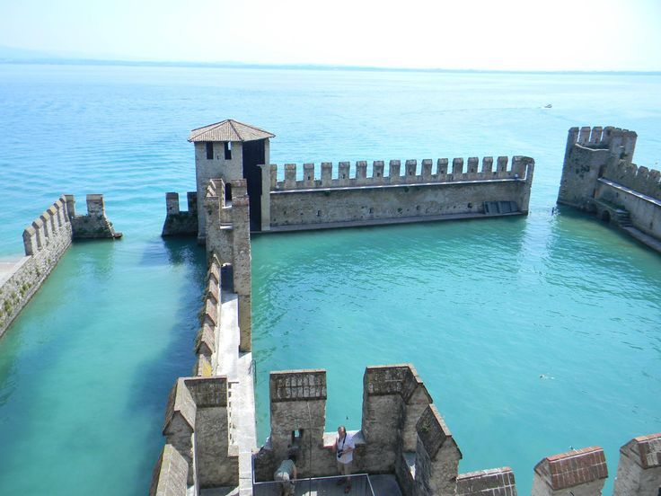 The Scaliger Castle in Sirmione, Italy. Resting on Lake Garda, the  once fortified castle is now a museum. You can climb the tower to enjoy the panoramic view of the lower lake area.