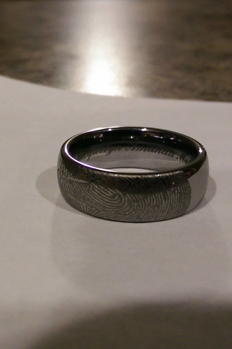 Perfect My tungsten wedding band is laser engraved with my wife us wedding ring fingerprint