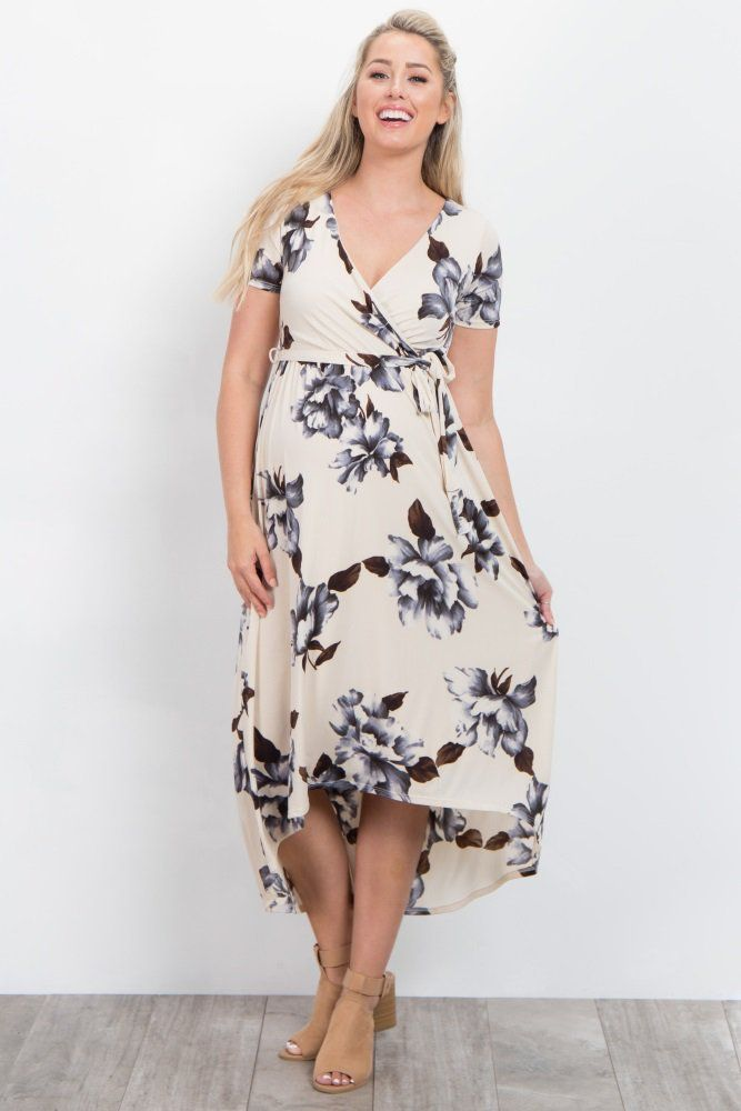 a6d2c1ca9dcbc Floral print maternity wrap dress. Hi-low hemline. Sash tie. Short sleeves.  Perfect for nursing after pregnancy. Double lined to prevent sheerness.