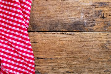 the background made from checkered napkin on old wooden ...