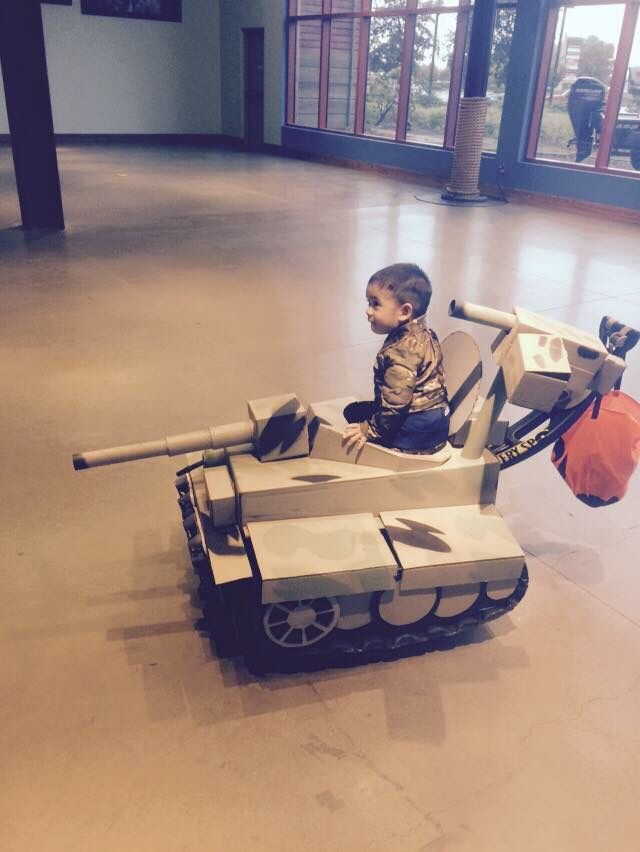 my son conor the tank commander with his tank made out of cardboard