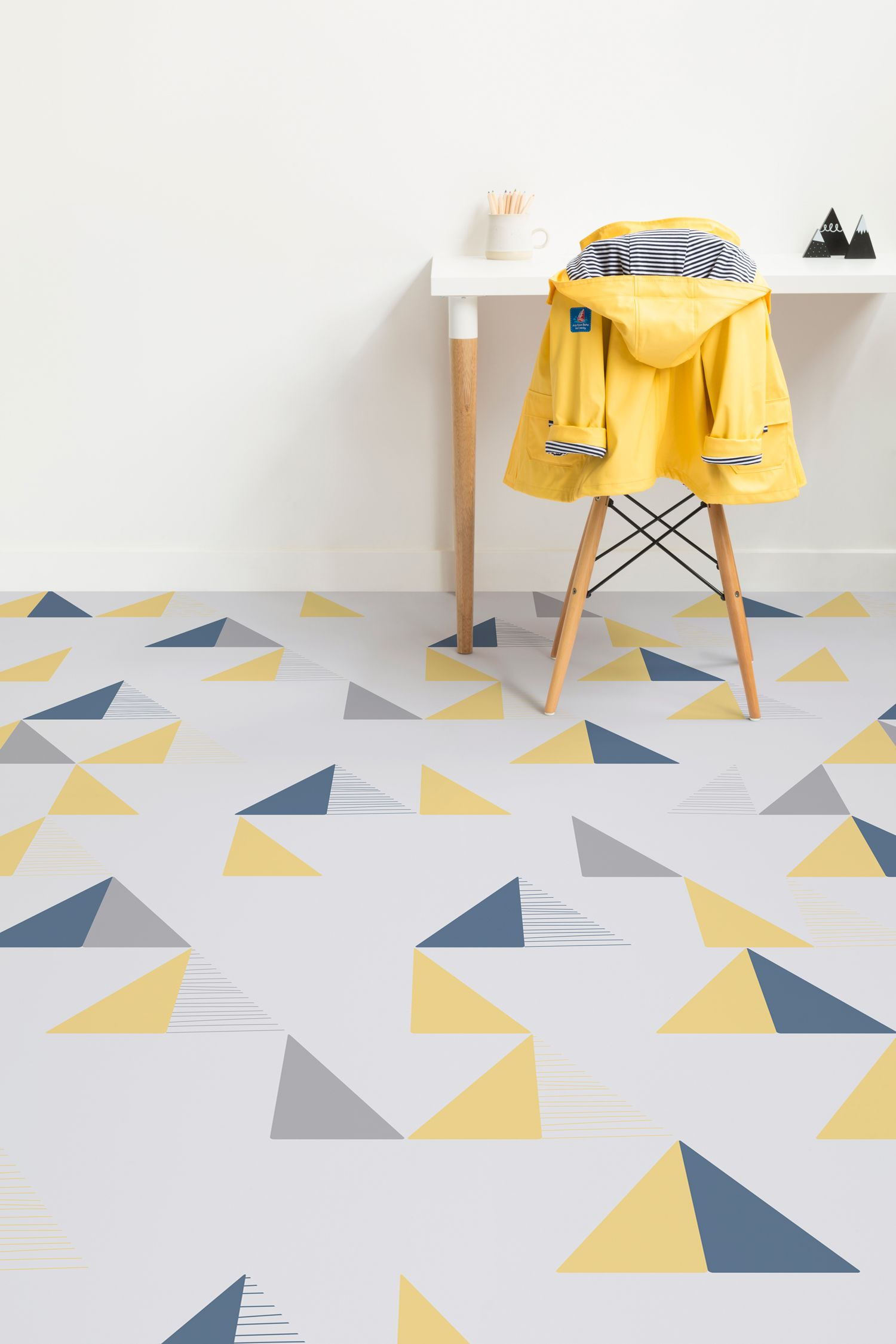 Montana Is A Triangle Modern Vinyl Flooring Design That Features Geometric Shapes In Bold Charming Blue Yellow And Grey Colours Against