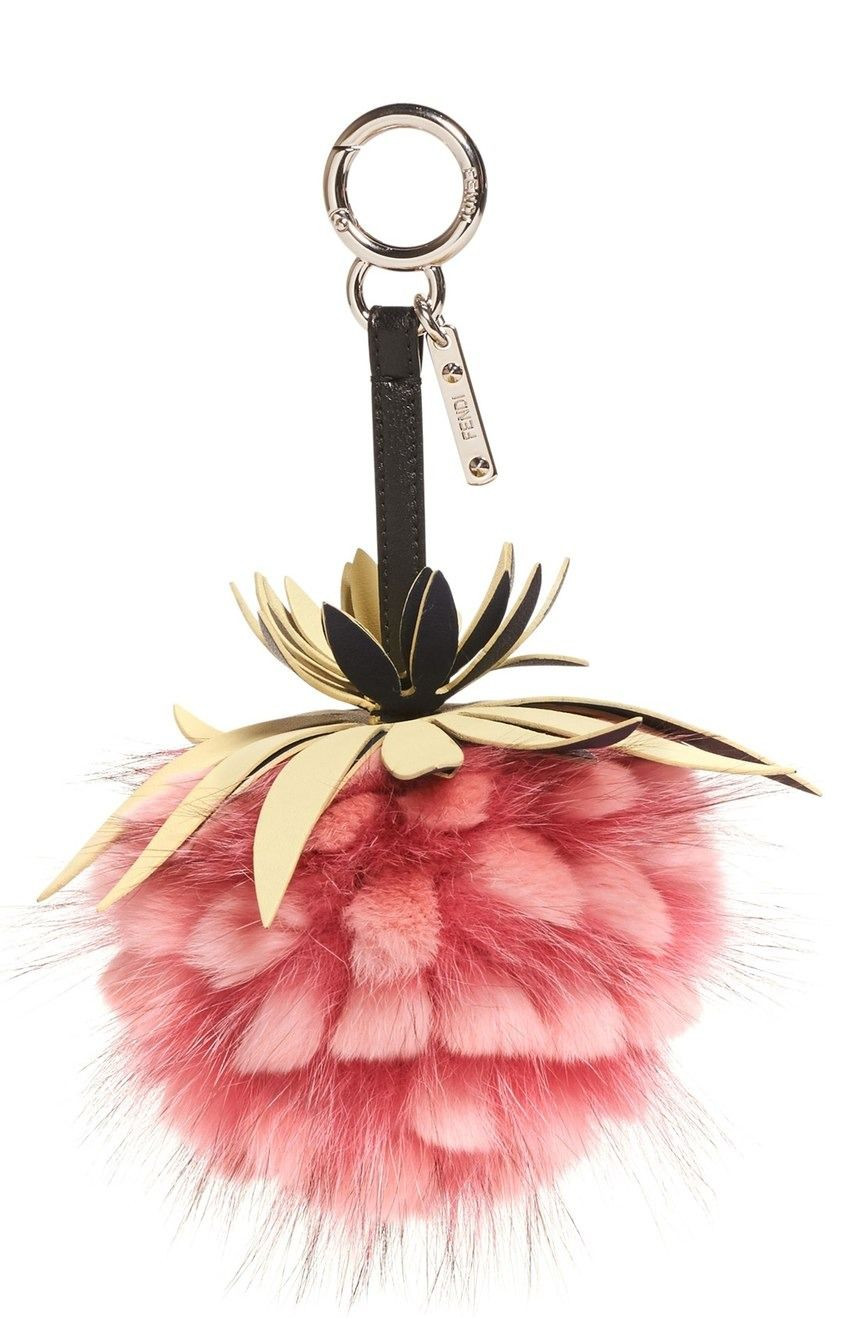 Give the fave handbag a dose of bright color and a tropical punch with this Fendi charm crafted from plush rabbit and fox furs.