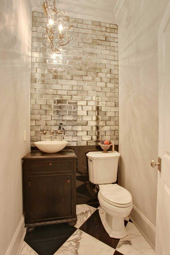 Mirrored Subway Tile Helps A Small Bathroom Feel Larger Powder Room Small Small Bath Home Hacks