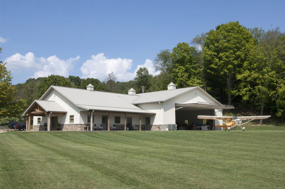 long barn house plans. LOVE this design  Home in front long shop across the back Barns