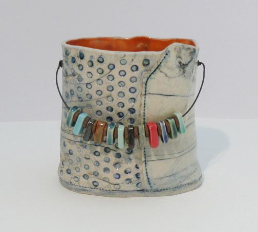 small porcelain vessel by bluedogceramics on Etsy. Love the use of colored chips on the handle.