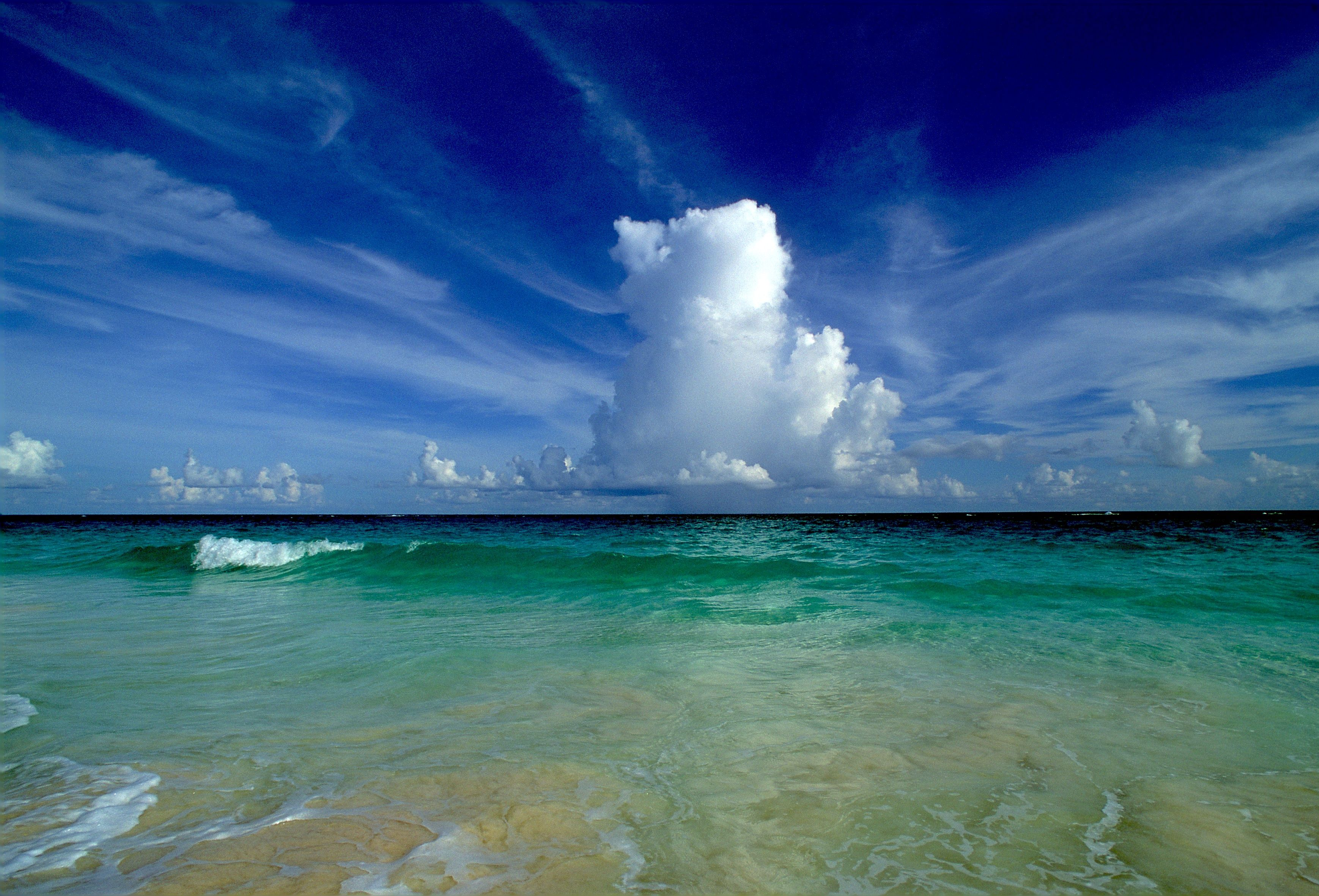 Cumulus clouds on the horizon, South Shore, Bermuda.-Scott Stallard