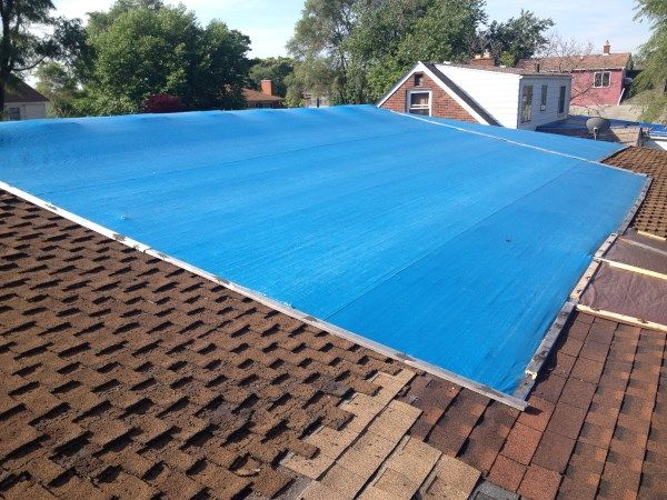 Install A Blue Tarp On A Roof Leaking Roof Leaky Roof Roofing