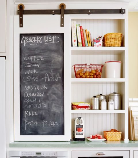 This barn-like door is the ultimate two-for-one: It hides unsightly appliances (like a waffle maker and deep fryer) and boasts a chalkboard inset panel for keeping track of grocery lists. (Door hardware: Rustica Hardware, $238; rusticahardware.com)