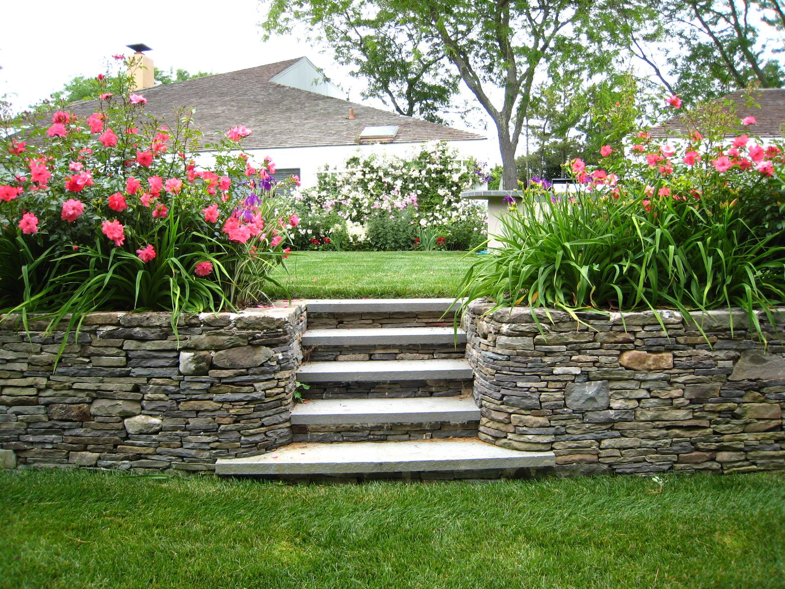 Stone retaining wall stone stairs home pinterest for Stone landscaping ideas