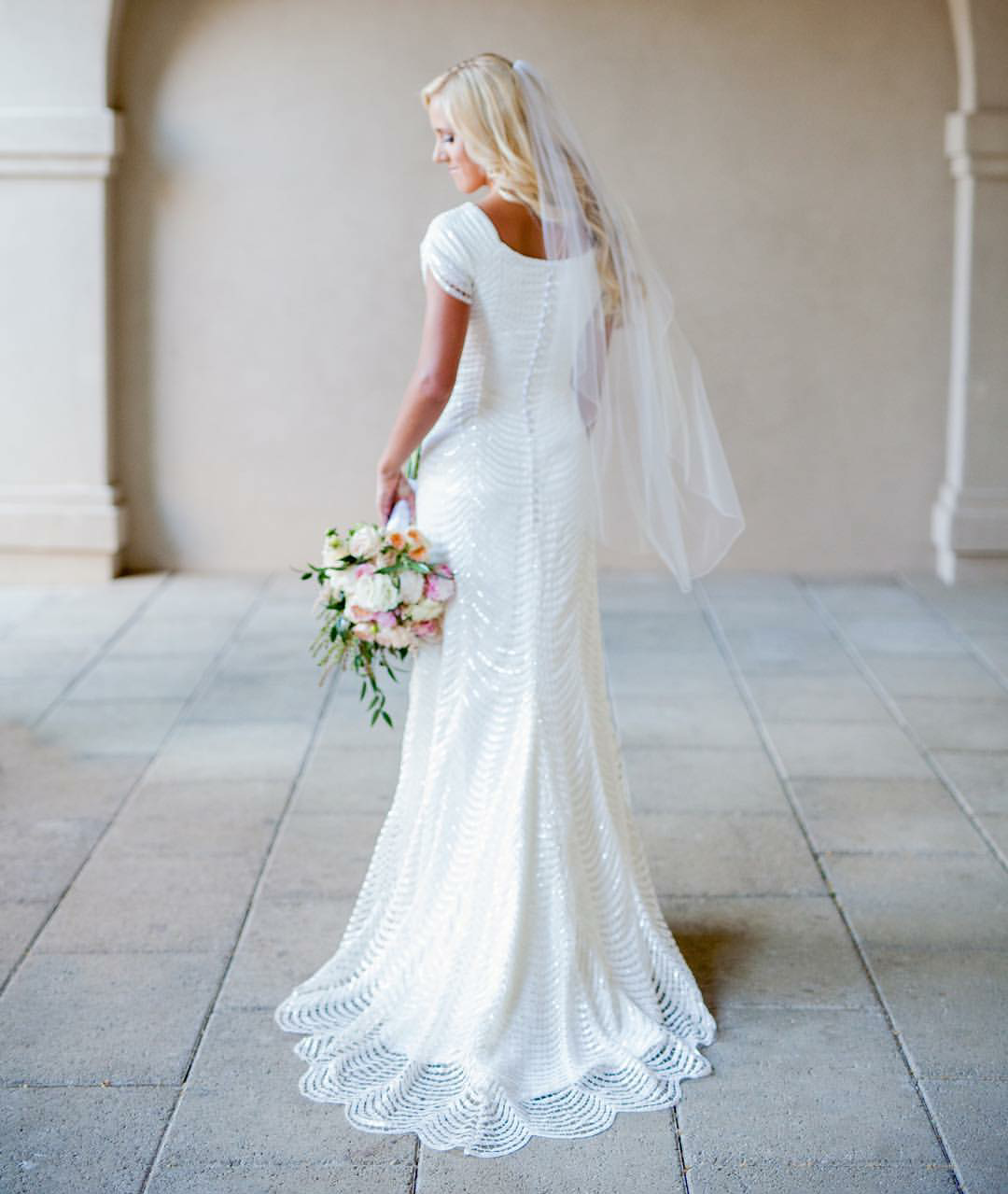 modest wedding dress with draped sleeves from alta moda ...
