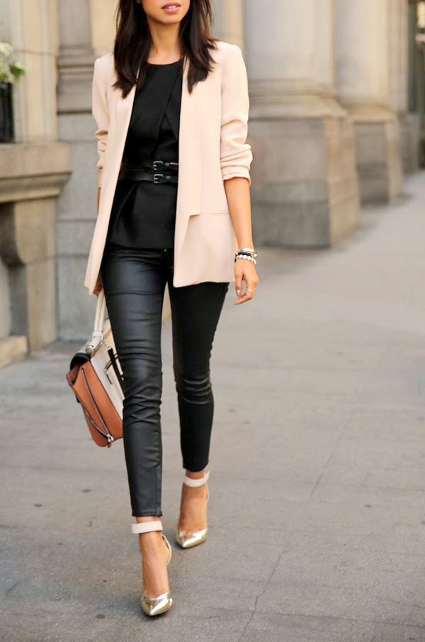3076ace4c4177 Simple and chic, with a pair of skinny jeans, strappy heels, and a light  pink blazer.