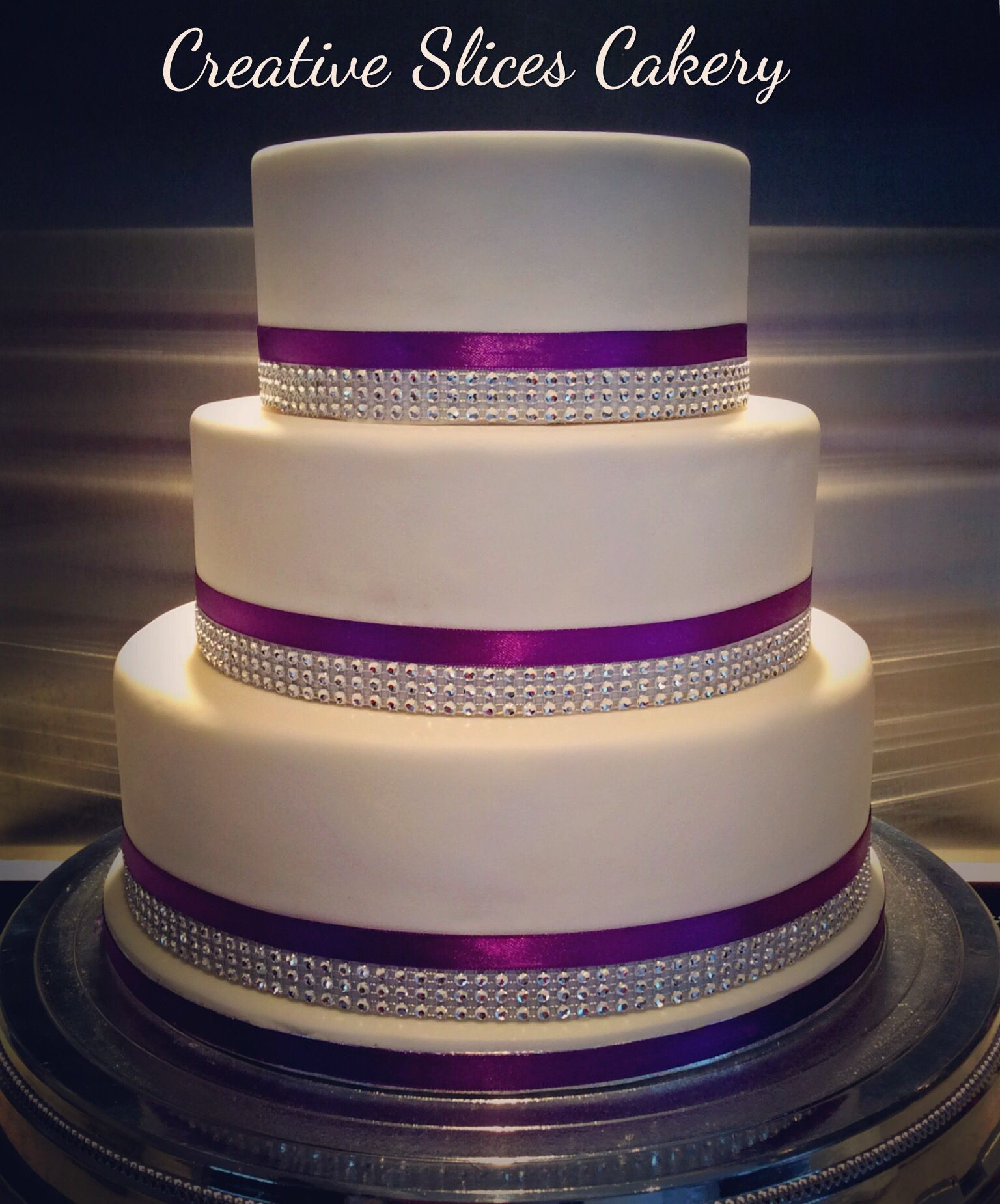 3 Tier Wedding Cake Covered In White Fondant With Diamante And