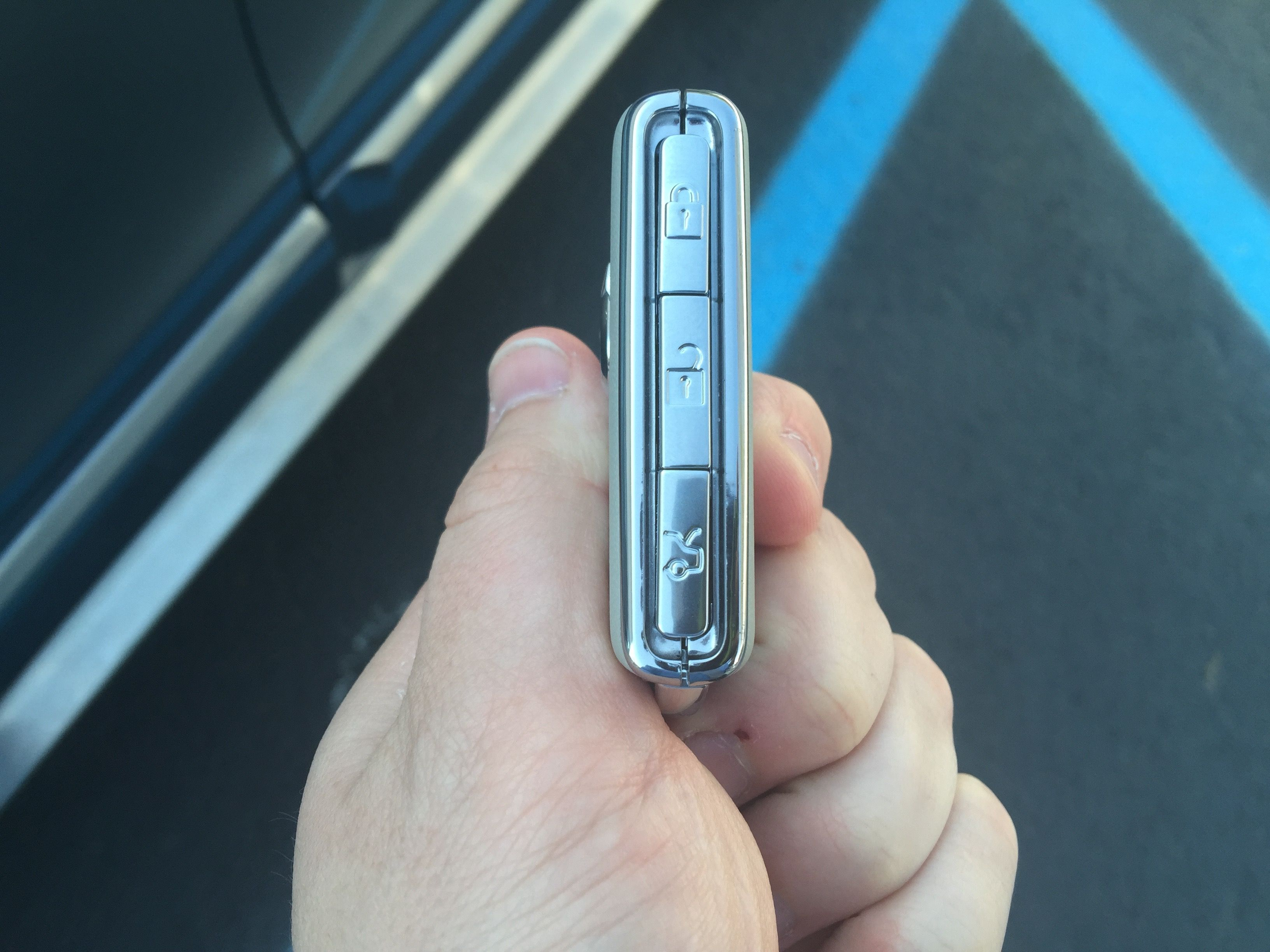 The Lock Unlock And Trunk Release Buttons On The Key Fob Of The