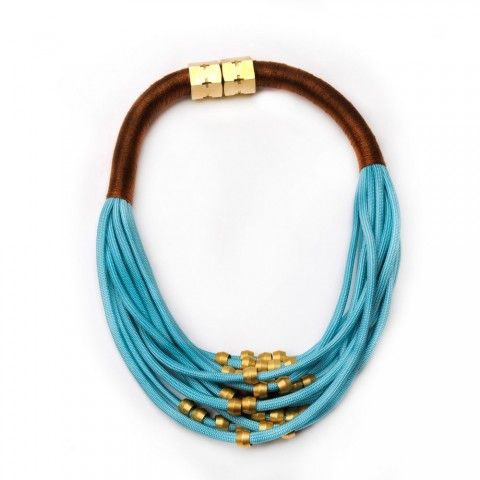 HOLST + LEE mixed fabric necklace features brass fixtures. Embossed logo lettering & magnetic closure.