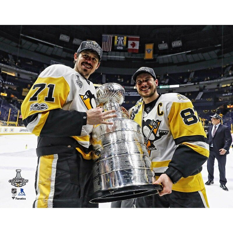 This original photograph features Sidney Crosby and Evgeni Malkin. It is officially licensed by the National Hockey League