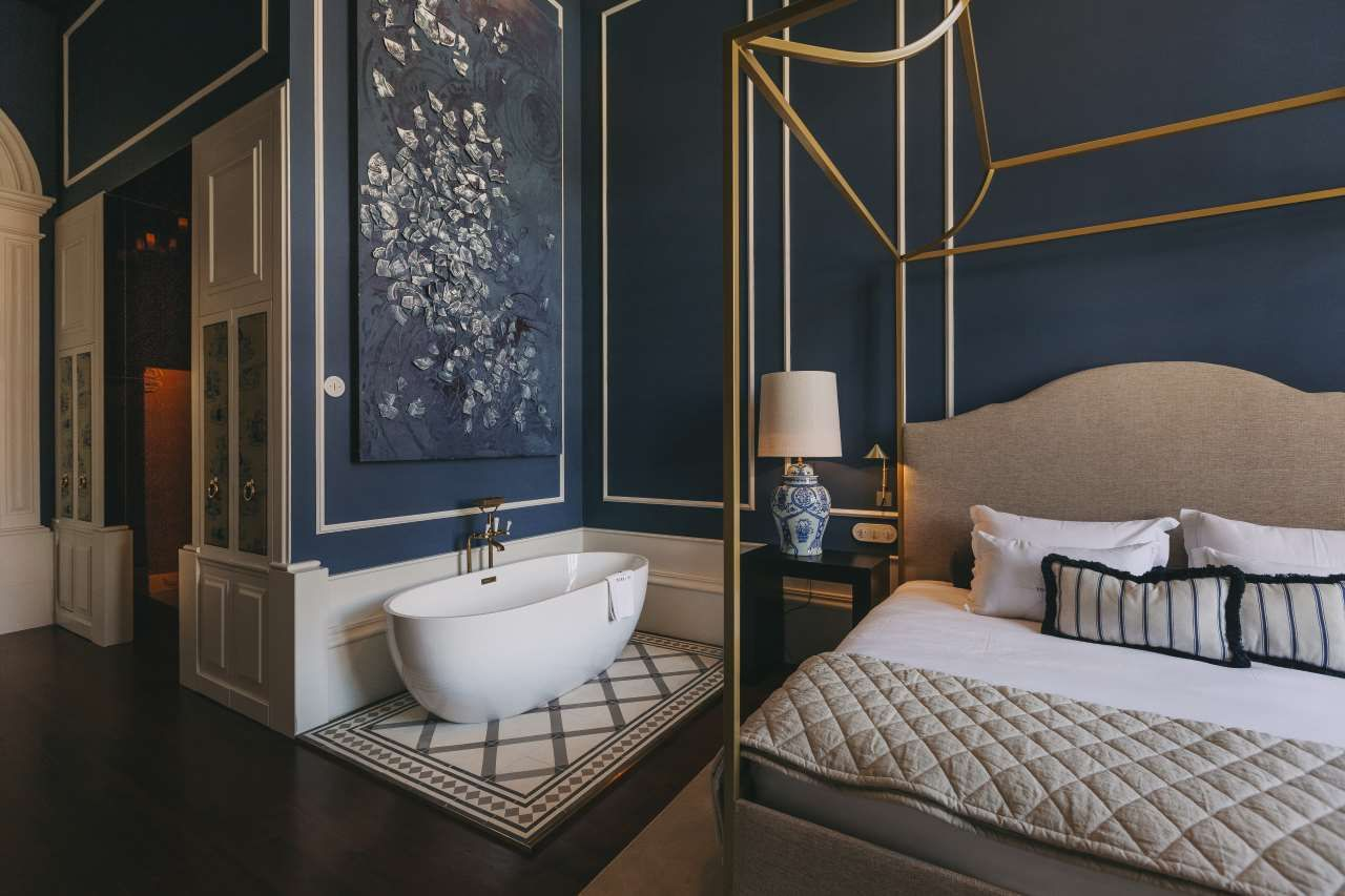 Blue bedroom with freestanding bath