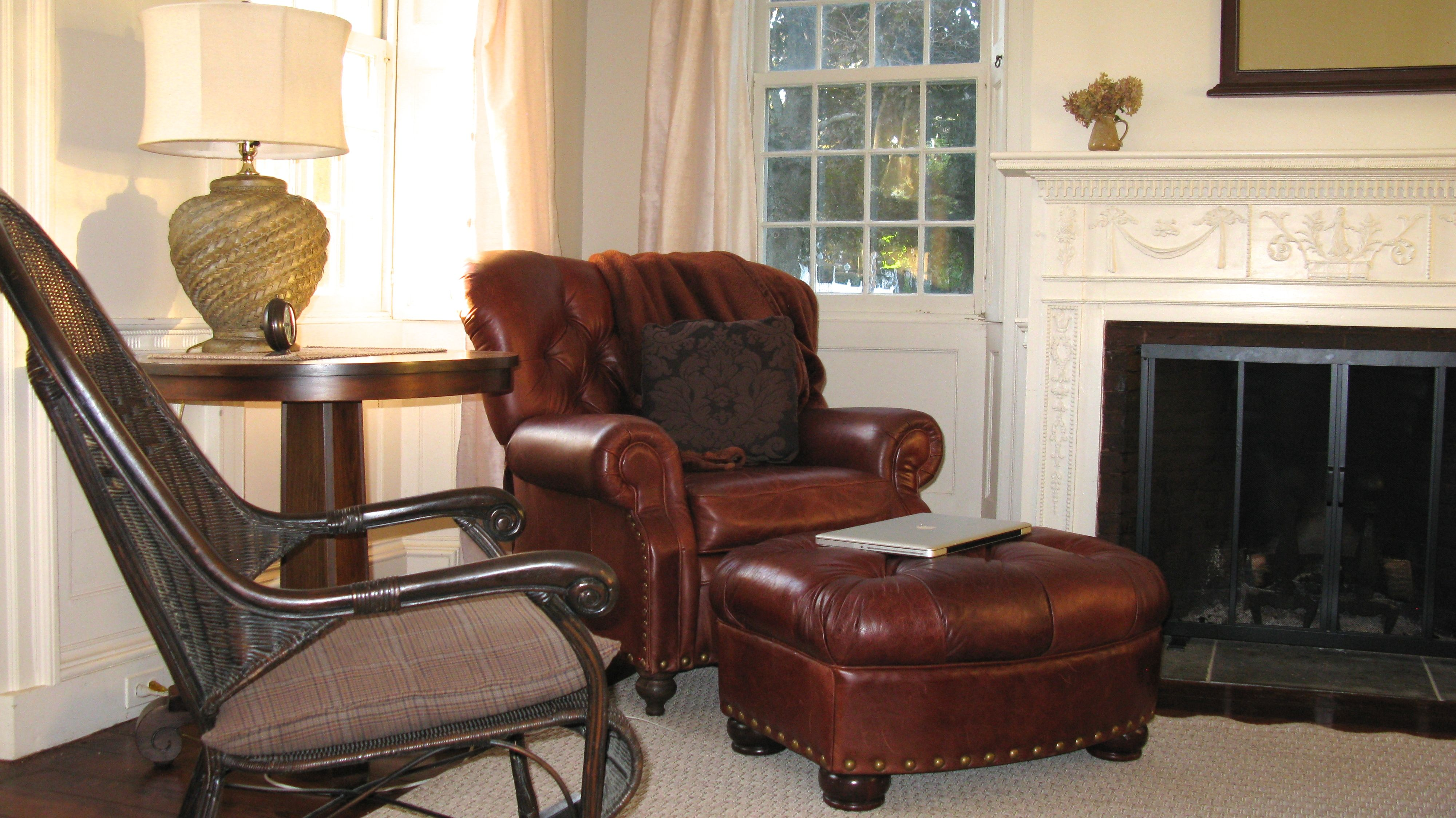 Tufted Leather Chair And Ottoman Fireplace Wicker Chair Sitting Room Living Family Living Rooms Parlor Room Family Room