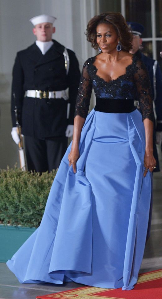 <p>Wearing a stunning (and seasonally appropriate) Carolina Herrera gown…
