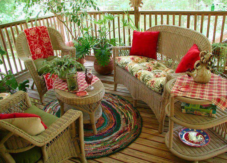 salon de jardin en rotin galettes de sige motifs fleuris et tapis rond multicolore