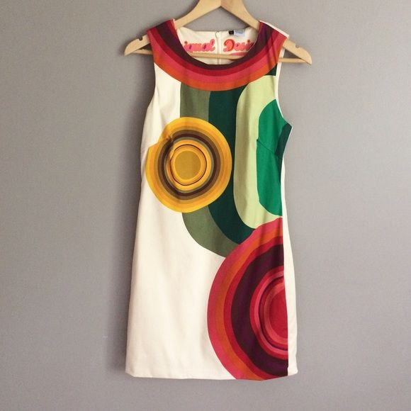 I just discovered this while shopping on Poshmark: Cream reds yellows greens fitted sleeveless dress. Check it out!  Size: 8, listed by sandi41075