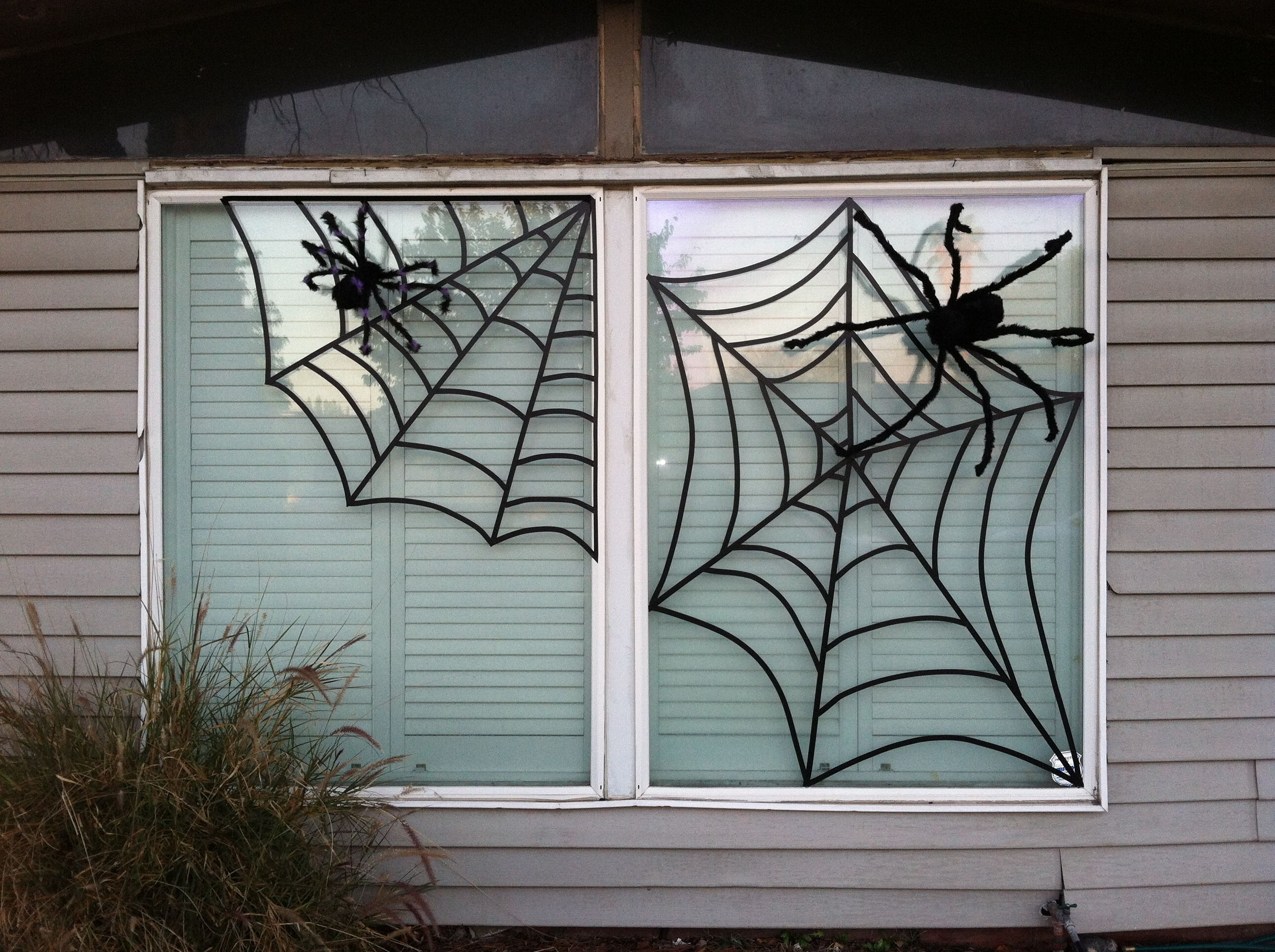 Electrical Tape Spider Webs The Tape Stretches So You Can Make The Arches For The Web Halloween Window Halloween Crafts Decorations Halloween Porch