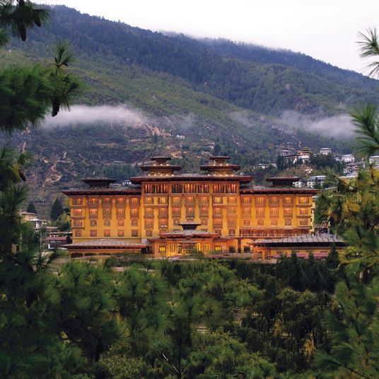 Taj Tashi Thimpu: aj Tashi Thimphu. Consider it a reward for trekking through the mountains, or for simply getting through the country's stringent visa process. The Taj group is known for planting its properties squarely at the intersection of local and decadent, and this one is no exception.  The hotel, whose dzong architecture lends it a fortresslike aspect, is situated in the middle of the capital city, ringed by the Himalayas. Bhutan pine and Thai silks cover the floors; detailed…