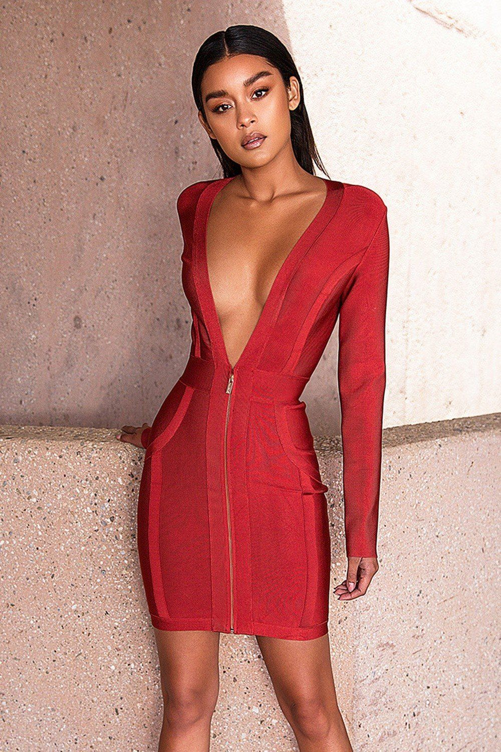 c4ea594b7a This deep v neck dress is the perfect piece to make a statement at your next