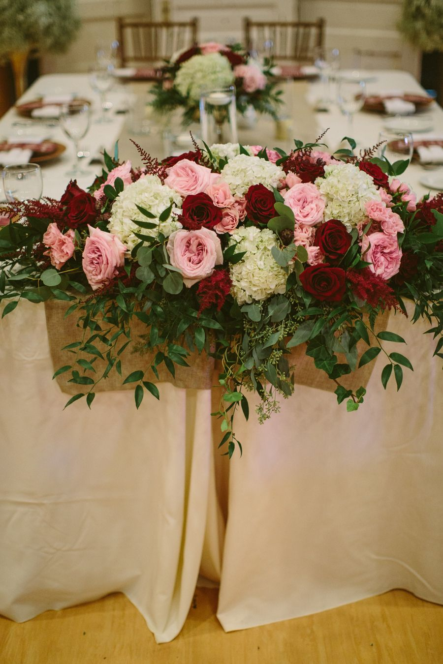 Head table floral arrangement to include pink o 39 hara for Flower sprays for weddings