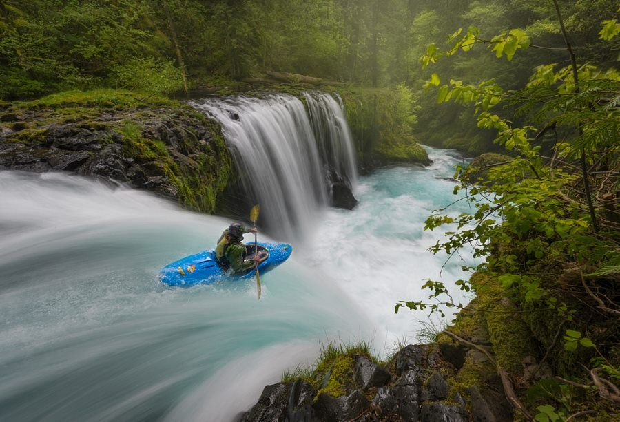 Kayaking down a waterfall in Columbia River Gorge.
