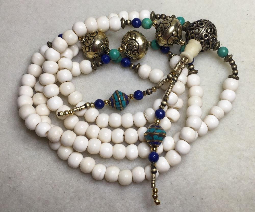 Lapis Lazuli /& handmade Napalese Brass Repousse beads Conch Shell Mala with Turquoise