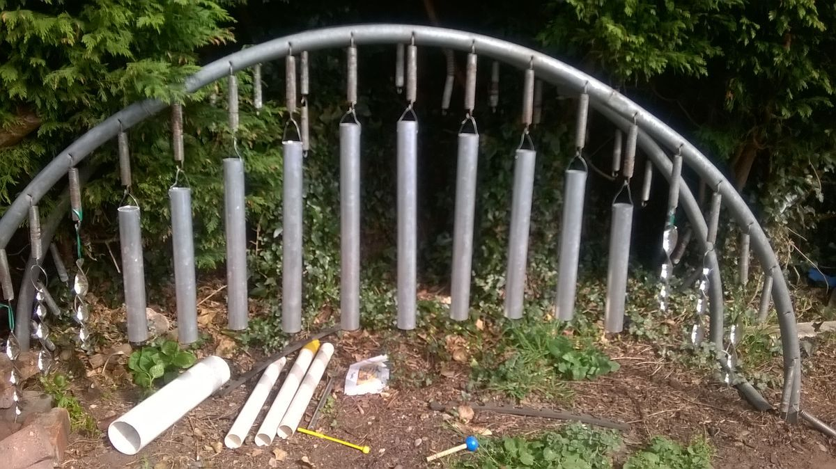 Our New Outdoor Xylophone . I Recycled Our Old Trampoline Frame And Used  The Springs To Hang The Metal Tubes.