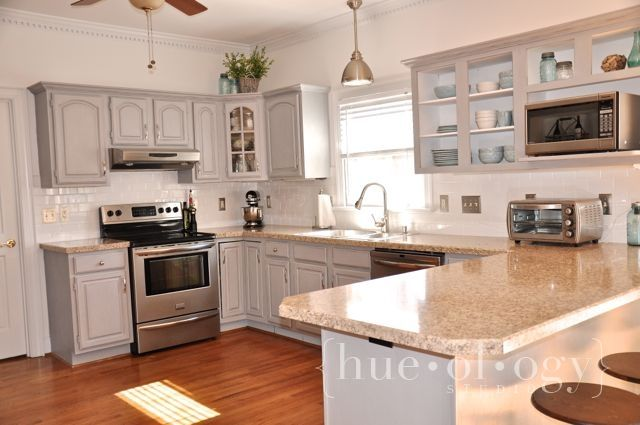Painted kitchen cabinets using paris grey chalk paint by for Annie sloan painted kitchen cabinets