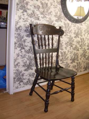 Black Oak Chair with Gray and White Wallpaper
