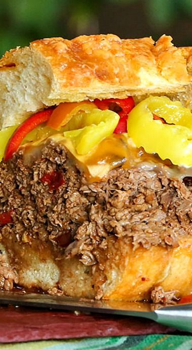 Hot & Spicy Roast Beef Sandwiches ~ Deli roast beef is simmered in spicy beef broth and served on crusty toasted bread, topped with ooey gooey cheese and peppers