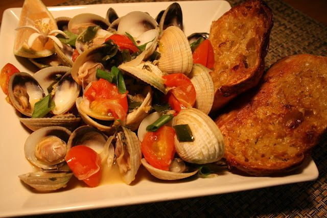 Fresh New Zealand Clams in Shock Top Lemon Shady Beer with Maui Onions, Scallions, Cherry Tomatoes, fresh Ginger and Butter; Focaccia Garlic Toasts; Lemon Wedge and Buddha's Hand Flower