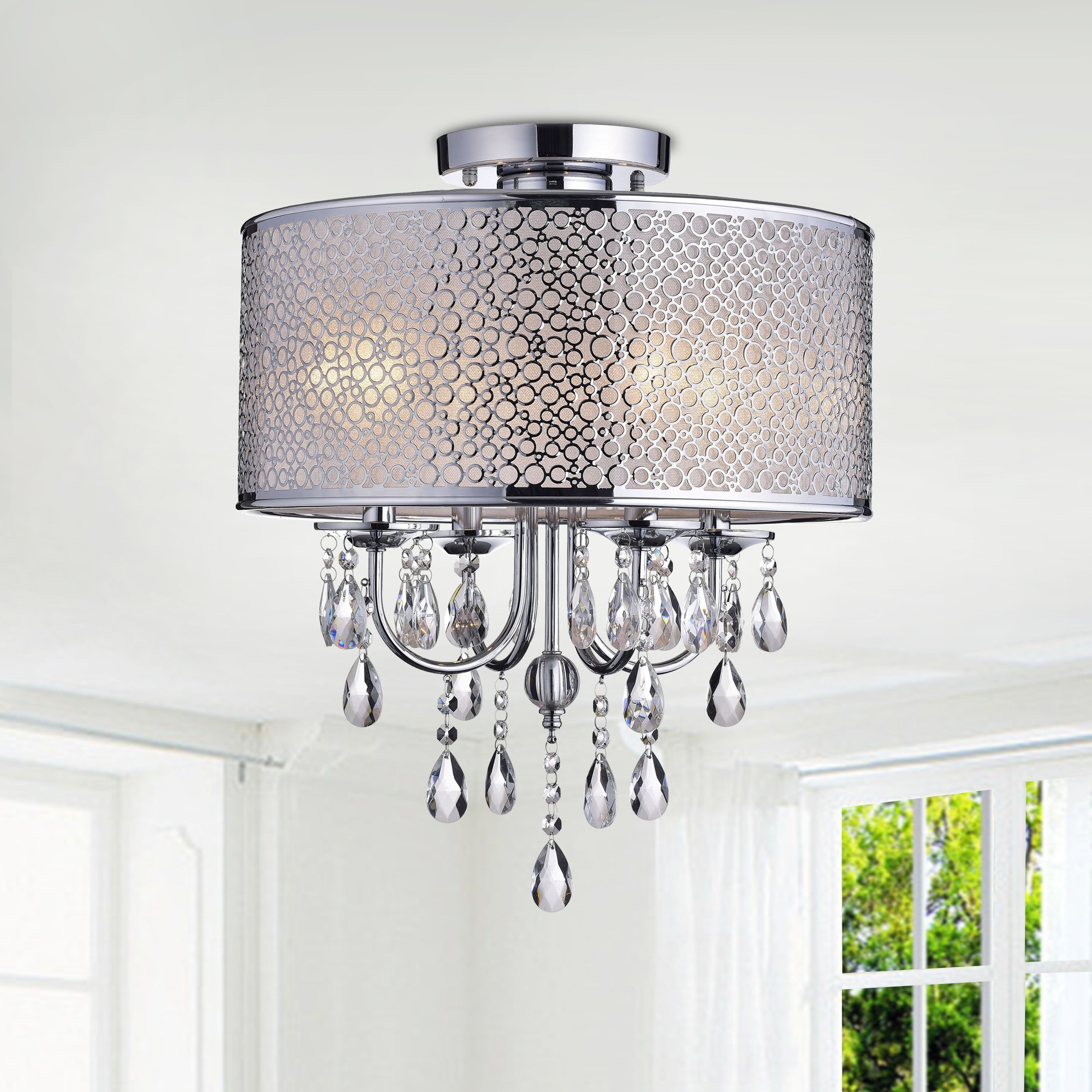 This Chandelier Features Gently Curved Arms In Shiny Chrome Fixture Finish Supporting Four Lights The Shade Is A Circular And Crystal Piece To Add