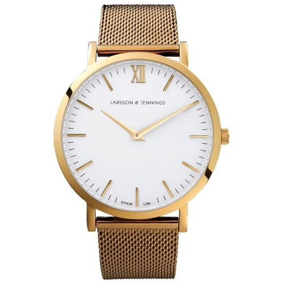 Larsson & Jennings CM   Gold Watch A unisex gold on gold combination. The CM   Gold features the classic 40mm polished gold plated 316L case and bezel housing a white dial detailed with gold hands and indexes. As good as new with original packaging. Orig price $380+tax Larsson & Jennings Accessories Watches