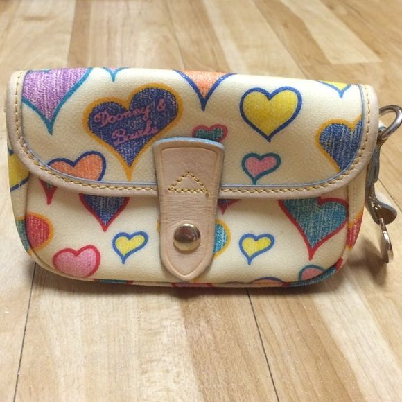 Authentic Small Dooney & Burke Hearts Wallet Authentic Small Dooney & Burke Hearts Wallet, this piece is vintage, with signs of love and wear--see pictures.The inner tag has the item serial number on it. It was made in the USA. Dooney & Bourke Bags Mini Bags